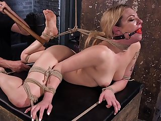 Gagged blonde gets fucked in crooked ways