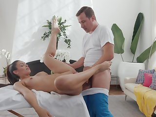 Adorable babe sure loves the masseur's big inches