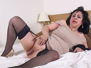 Mature brunette amateur Virginia pounds her pussy with toys solo