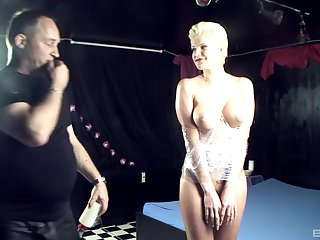 Submissive blonde Scarlet Young stuffed with two cocks on the table