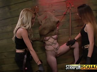 Two mistresses wearing strapons be captivated by compelled up and restrained bitch Sheena Rose