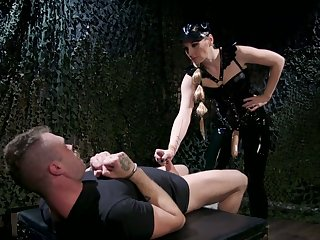 Mistress in latex puts on strapon and fucks anus be incumbent on one kinky submissive
