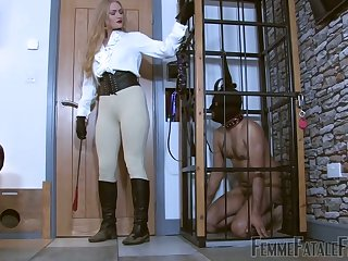 Submissive on a leash licks abusive boots be required of sexy mistress Dommelia