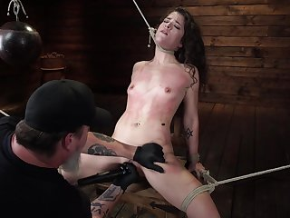 Crazy and reprobate Victoria Voxxx enjoys hardcore games while she hangs tied