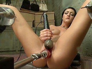Solo brunette fucks apparatus and squirts