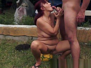 Saggy redhead granny fucked outdoors