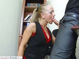 Blonde secretary Kylie Wilde stripteases and fucks wild on the table